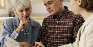 Senior Couple Reviewing Trust with Estate Planning Lawyer   Law Offices of David L Carrier