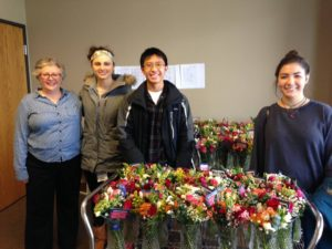 Volunteers deliver flowers for Valentine's Day