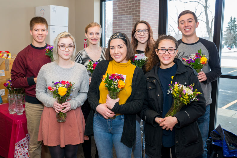 David Carrier staff and Rockford High students deliver Valentine's flowers