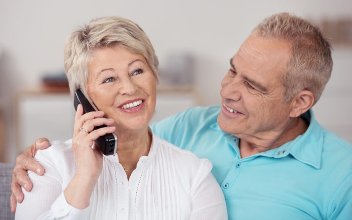 elderly couple on phone