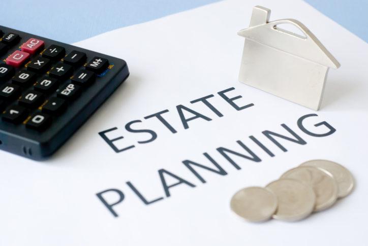 estate planning packet on blue background