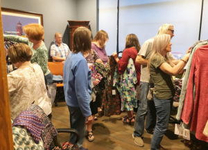 shoppers browse clothes and merchandise at the law offices of david carrier