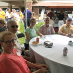 Visitors to the David Carrier classic car cruise-in enjoy food and beverages