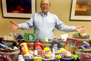 david carrier shows off donations collected for santa for a senior program