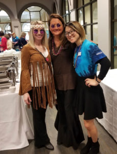 carrier law staff members wearing 60s attire at peace, love and aging conference