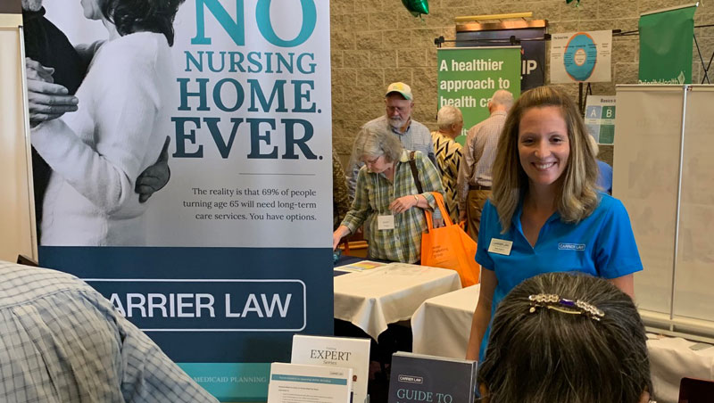 carrier law staff at their booth at the Senior Marketing Group Lakeshore Area event in Holland, MI