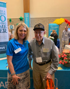 Kris Cleary of Carrier Law visits with an attendee of the Senior Marketing Group of the Lakeshore Area in Holland, MI
