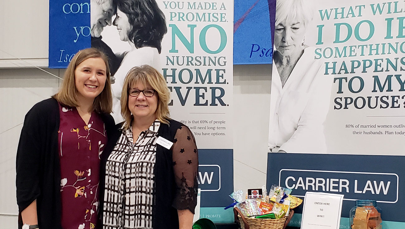 carrier law staff at the pop-up health fair booth in Portage, MI