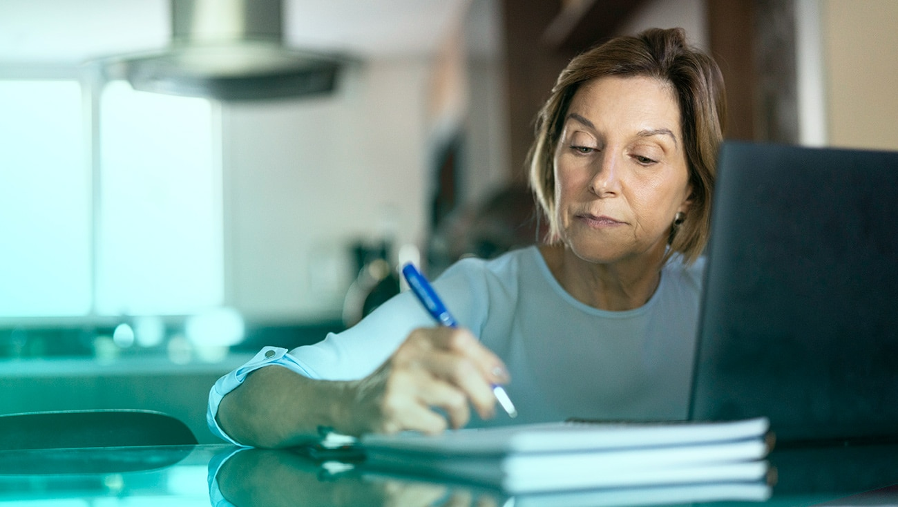 Woman at computer filling out paperwork